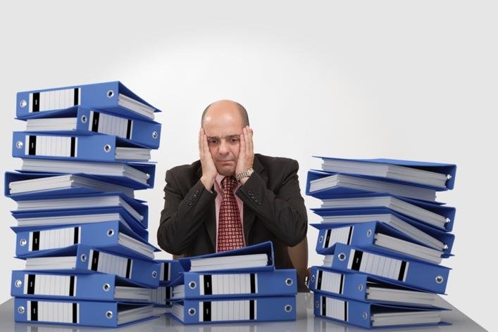 Overloaded Man at desk